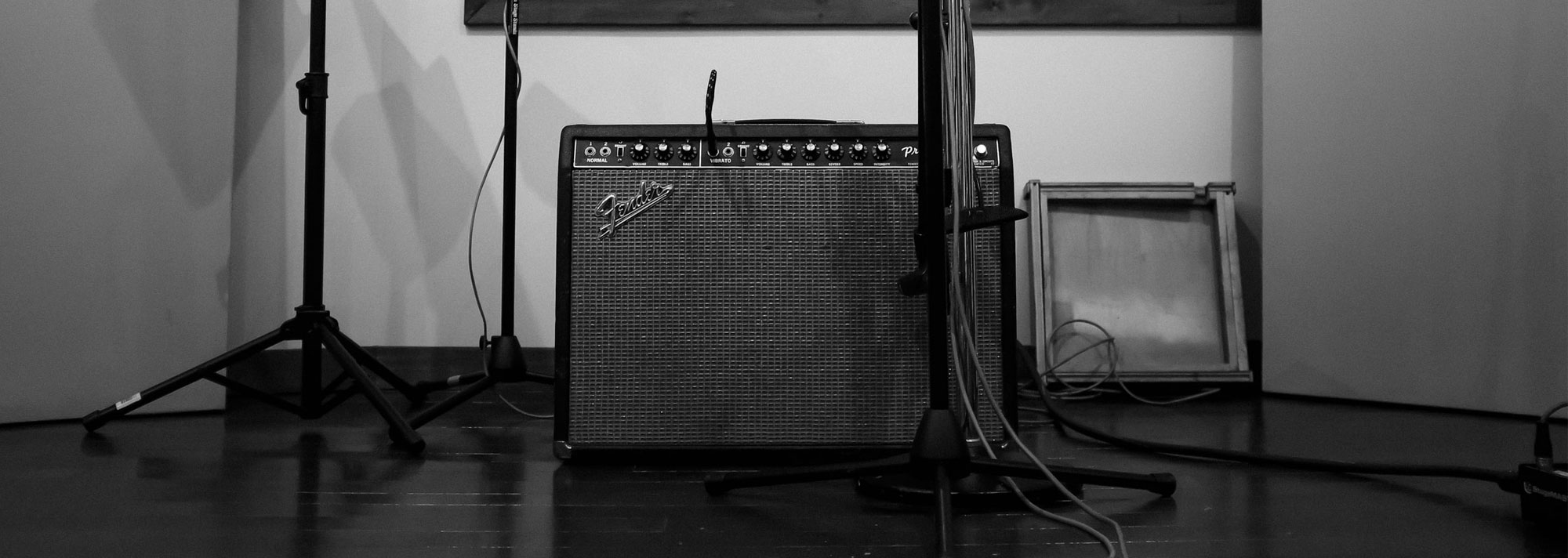 Fender Princeton amplifier with music stand and microphone in a recording studio booth